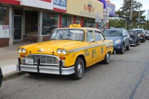 Vintage_Checker_Cab_Downtown_Ypsilanti_Michigan[1]